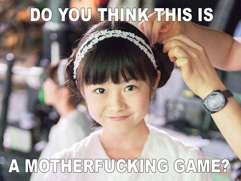 """Yuimetal from Babymetal in a photo taken during her early tenure with Sakura Gakuin, dressed as an angel; the caption reads """"Do you think this is a motherfucking game?"""""""